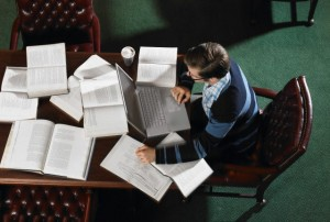 Young adult man studying